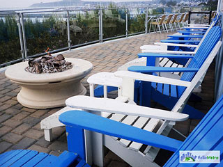 fire pit and Adirondack chairs on Sam's outdoor patio